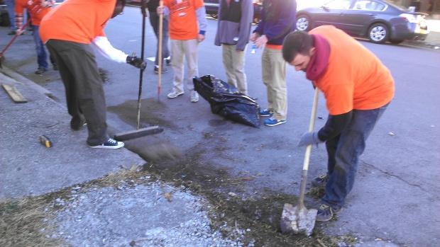 Some of the volunteers got the thrilling job of scraping dirt and weeds off the empty lot and curb.  Amazing what a difference it made.
