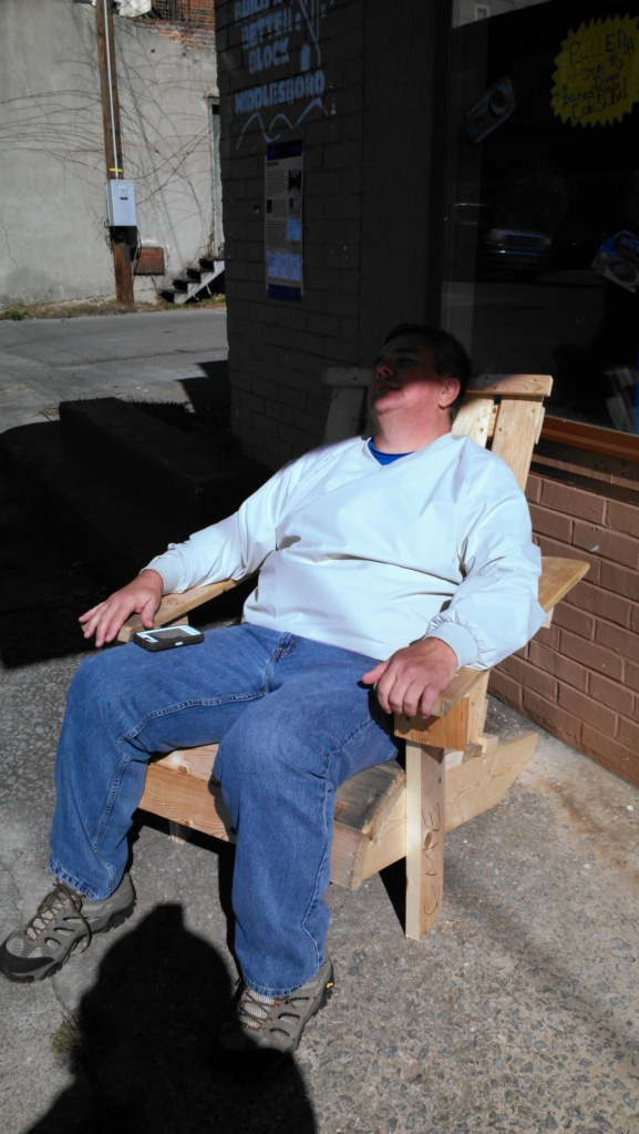 Mayor Bill Kelley takes a rest in one of the pallet chairs - outside of the pop-up restaurant he was running that day.